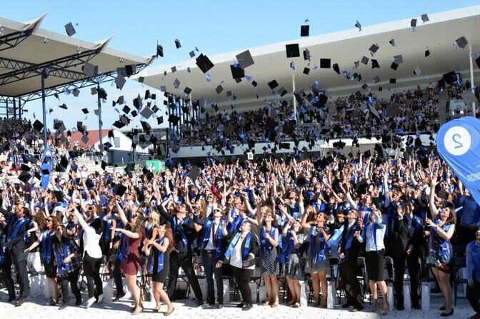 Graduates throwing their hats up in the air